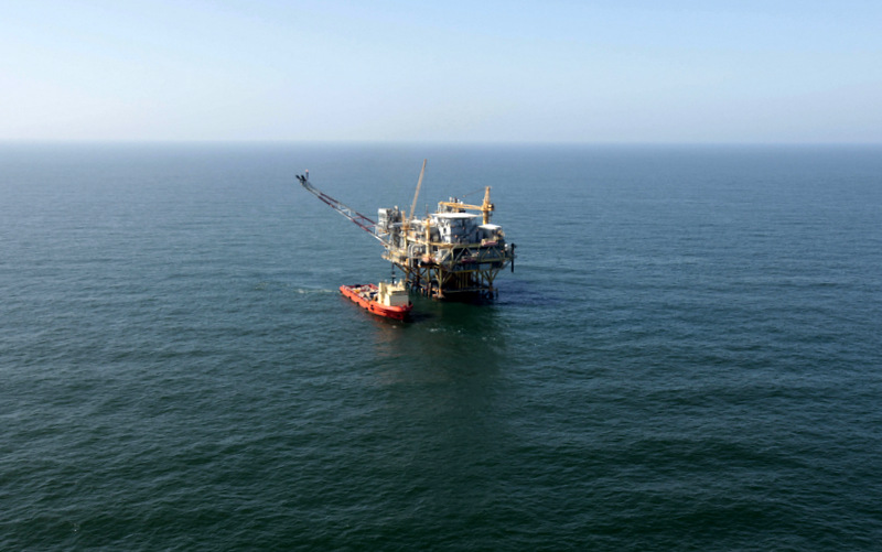 A view of an oil rig in  the Gulf of Mexico, 50 miles off the cost of Louisiana, on Sunday, April 10, 2011. (AP Photo/Gerald Herbert)