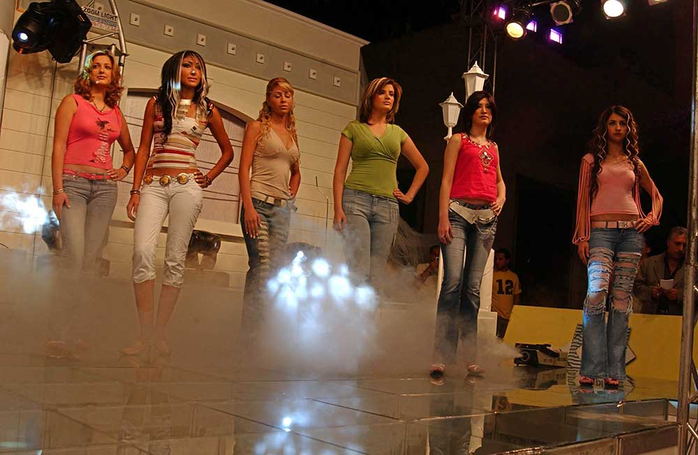 Syrian girls competing for Miss Fashion Model, in Damascus, strut their stuff on the catwalk in 2006. (Photo Norbert Schiller)