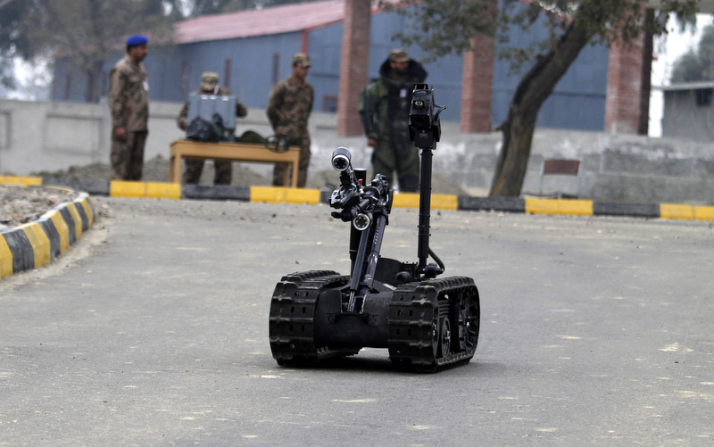 Pakistani soldiers use remote controlled vehicle to approach possible explosive devices during a training session at the Counter IED Explosives and Munitions School, in Risalpur, Pakistan. (AP Photo/Anjum Naveed)