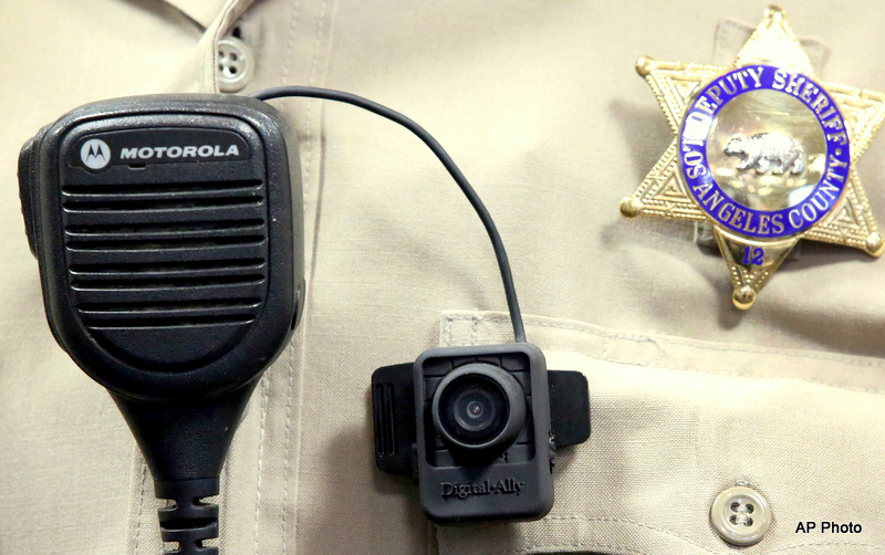 A Police body camera is displayed at a news conference