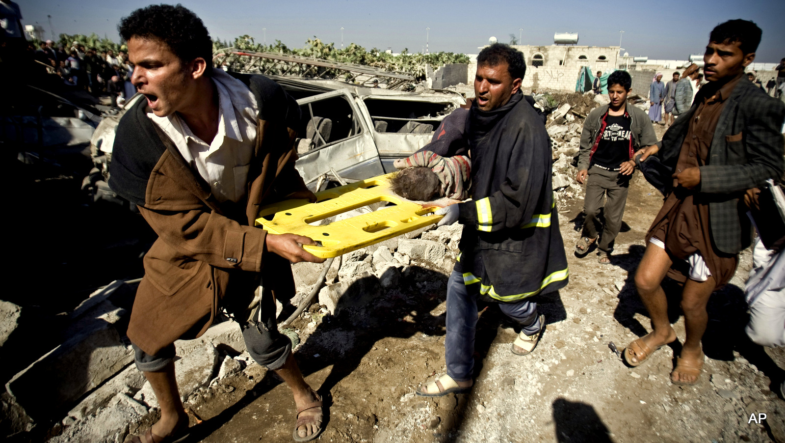 YemenPeople carry the body of a child they uncovered from under the rubble of houses destroyed by Saudi airstrikes near Sanaa Airport, Yemen, Thursday, March 26, 2015. Saudi Arabia launched airstrikes Thursday targeting military installations in Yemen held by Shiite rebels who were taking over a key port city in the country's south and had driven the embattled president to flee by sea, security officials said.