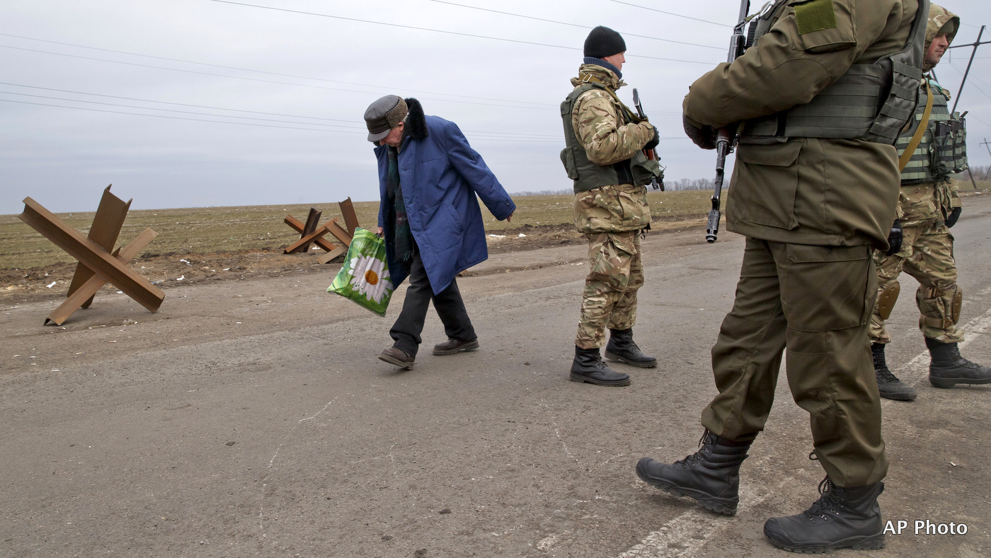 An elderly man crosses a Ukrainian army checkpoint near Kurakhove, Ukraine. (AP Photo/Vadim Ghirda)