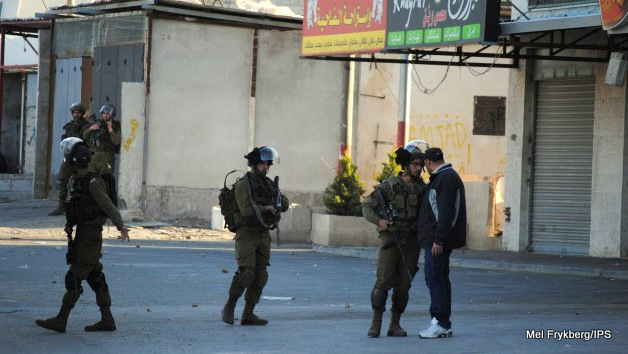 Unarmed Palestinian confronts Israeli soldiers