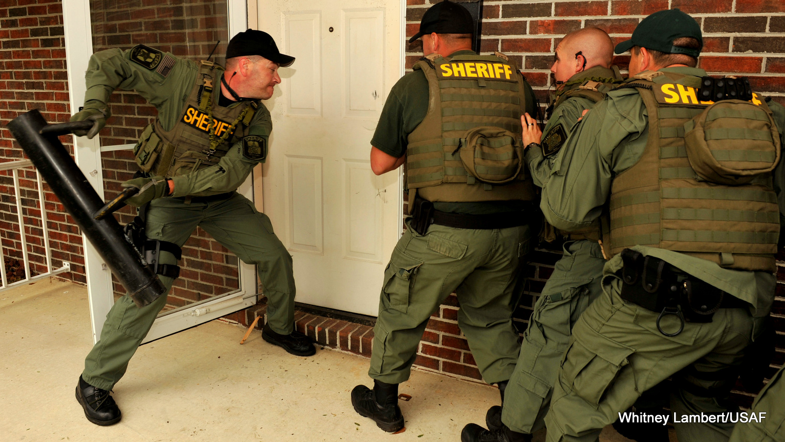 A Duplin County Sheriff's Office special response team prepares to shatter a door, and presumably it's owners 4th Amendment rights, during a training exercise.