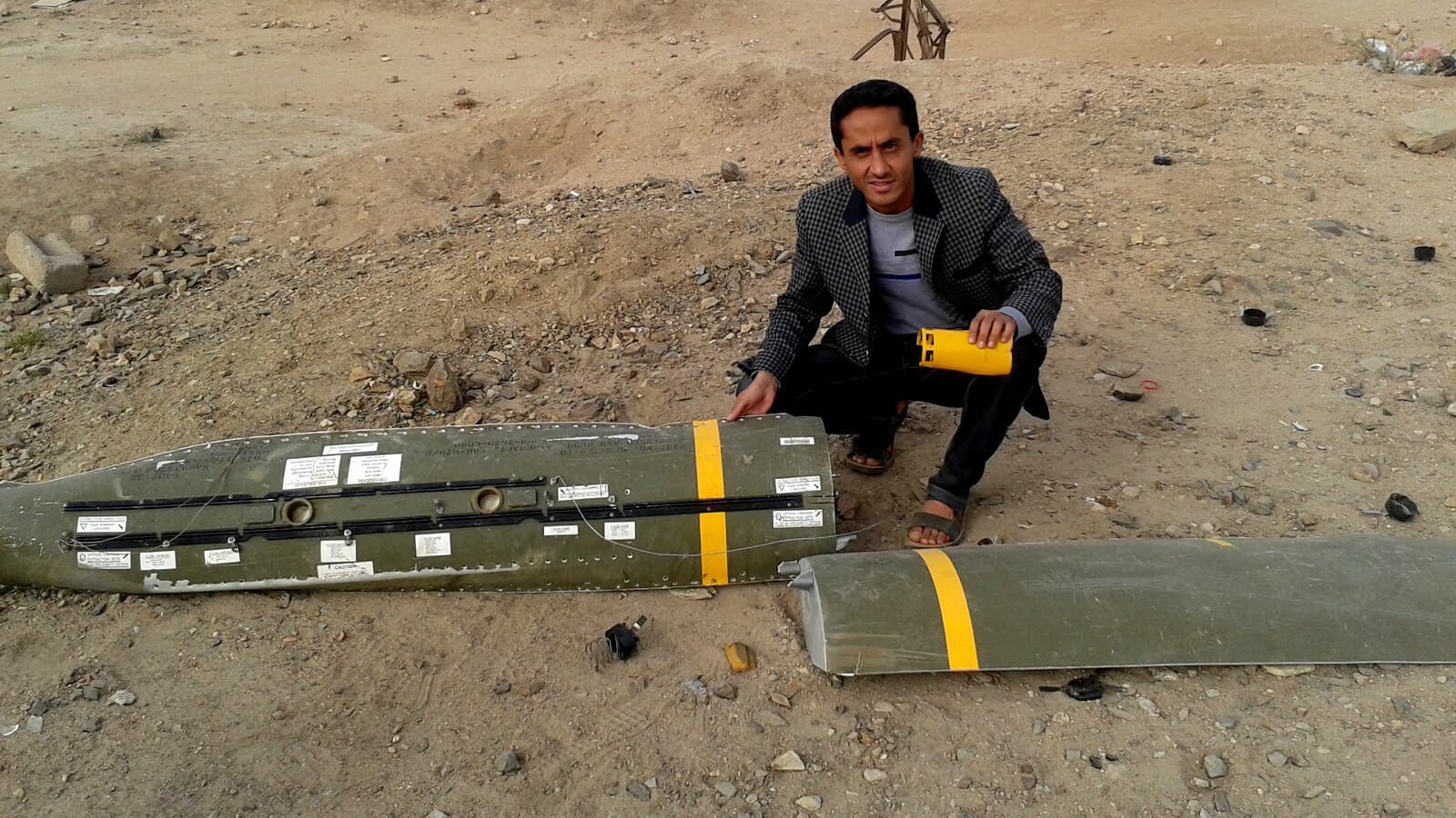 Hussain Albukhaiti poses with the remnants of a U.S.-made munition dropped by Saudi Arabia on Sanaa, Yemen. Photo | Hussain Albukhaiti