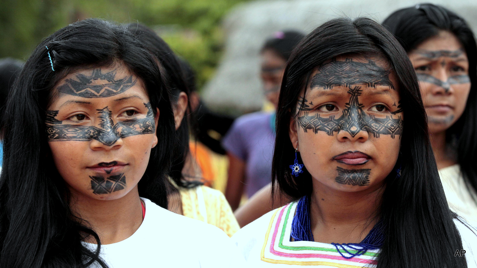 Sarayaku women attend a ceremony where the Ecuadorian Government offered a public apology that came as part of a ruling by the Inter-American Human Rights Court which found that the government allowed for oil exploration in Sarayaku lands without their consent.  Indigenous people will have access to the courts as part of a recent historical declaration protecting the  rights of Indigenous peoples through-out the Americas, with the exception of the U.S. and Canada.
