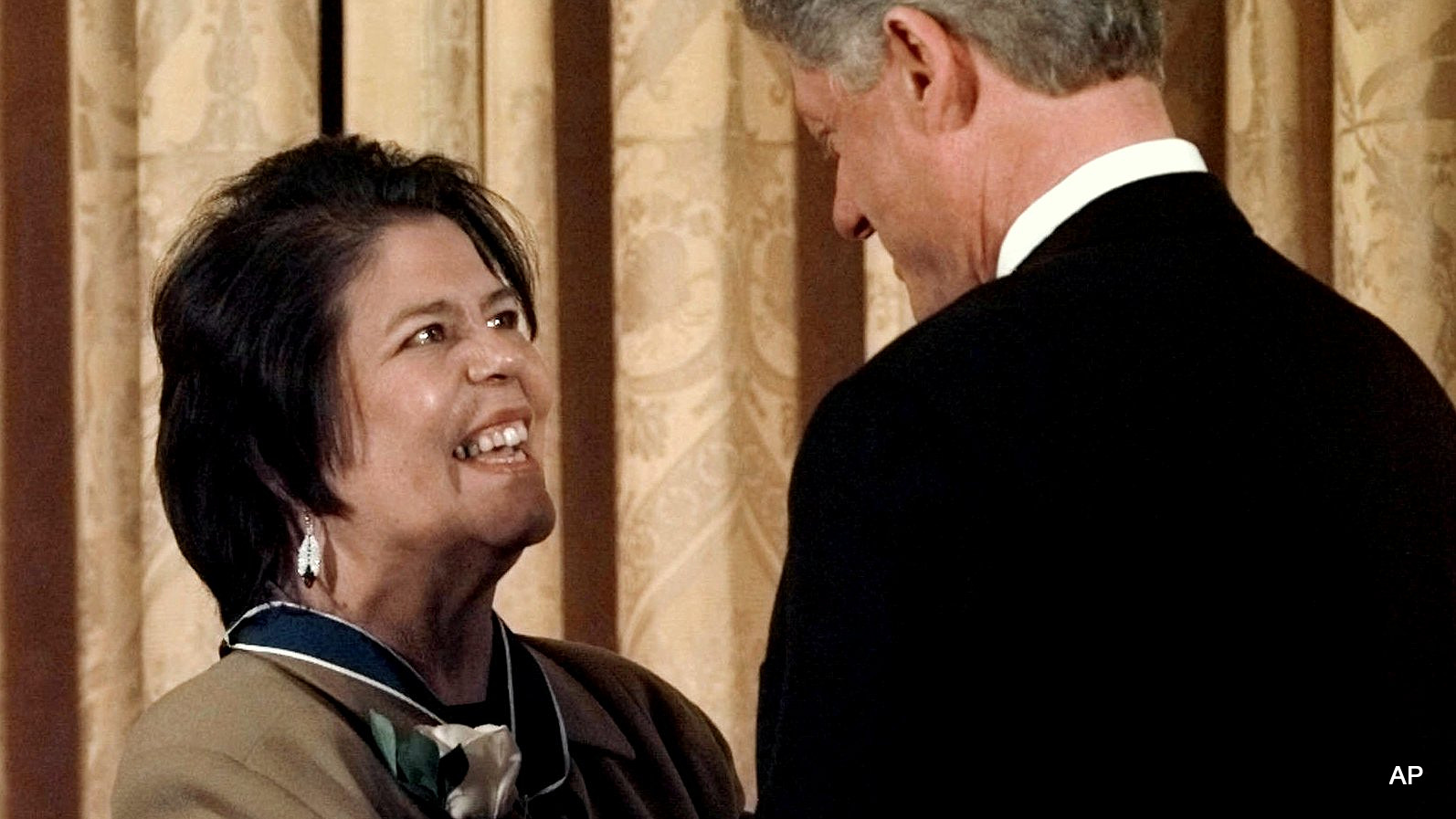 President Bill Clinton hugs former Cherokee Nation chief Wilma Mankiller after presenting her with a Presidential Medal of Freedom during a ceremony at the White House, Jan. 15, 1998 .