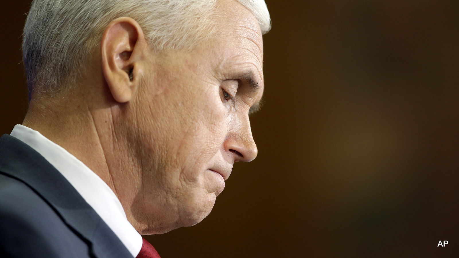 Indiana Gov. Mike Pence listens to a question during a news conference, Tuesday, March 31, 2015, in Indianapolis. Pence said that he wants legislation on his desk by the end of the week to clarify that the state's new religious-freedom law does not allow discrimination against gays and lesbians.