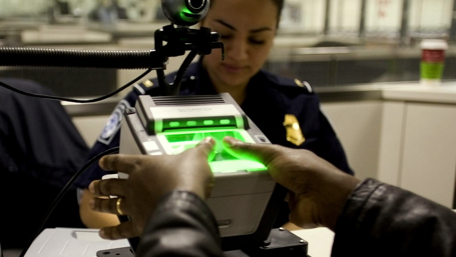 A traveler arriving at Washington Dulles International Airport Monday uses the new US-VISIT mechanism that records all 10 fingerprint images. Photo: Gerald Nino/CPB