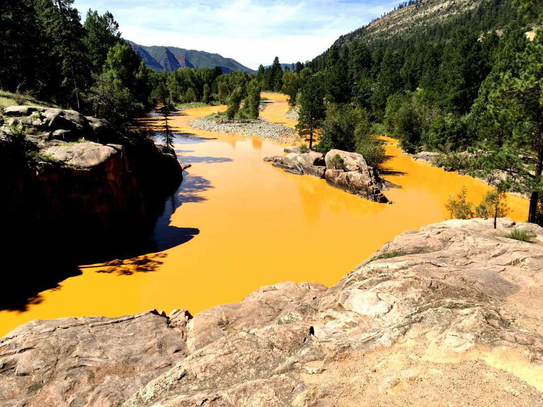 08/06/15-Durango - Mine waste from the Gold King Mine north of Silverton fills the Animas River at Bakers Bridge on Thursday morning. Photo: Jerry McBride/Durango Herald