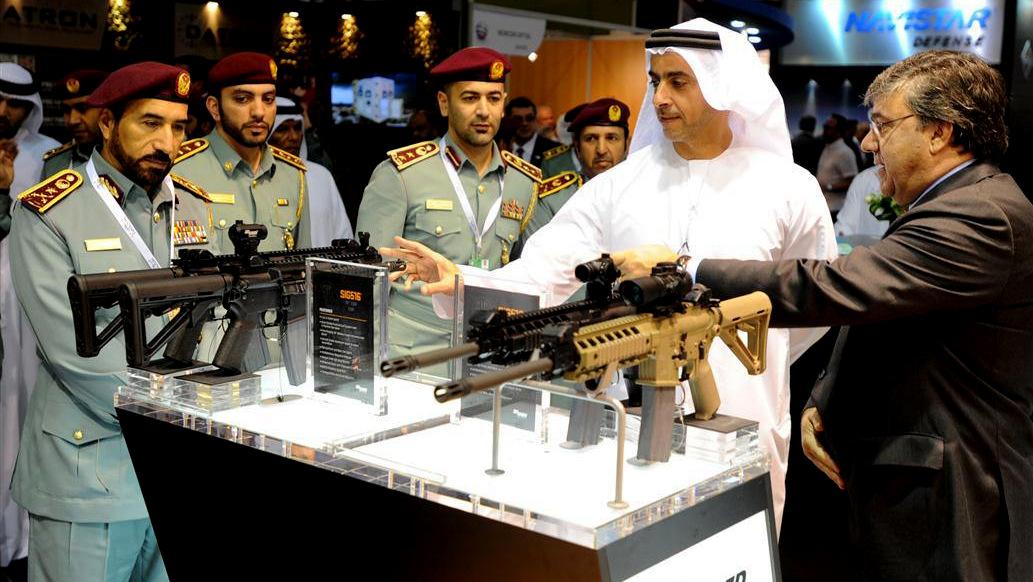 Sheikh Mohammed bin Rashid Al Maktoum, Ruler of Dubai, inspects the goods at the 2013 DSEi international arms fair.