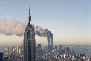 The twin towers of the World Trade Center burn behind the Empire State Building in New York.(AP Photo/Marty Lederhandler)
