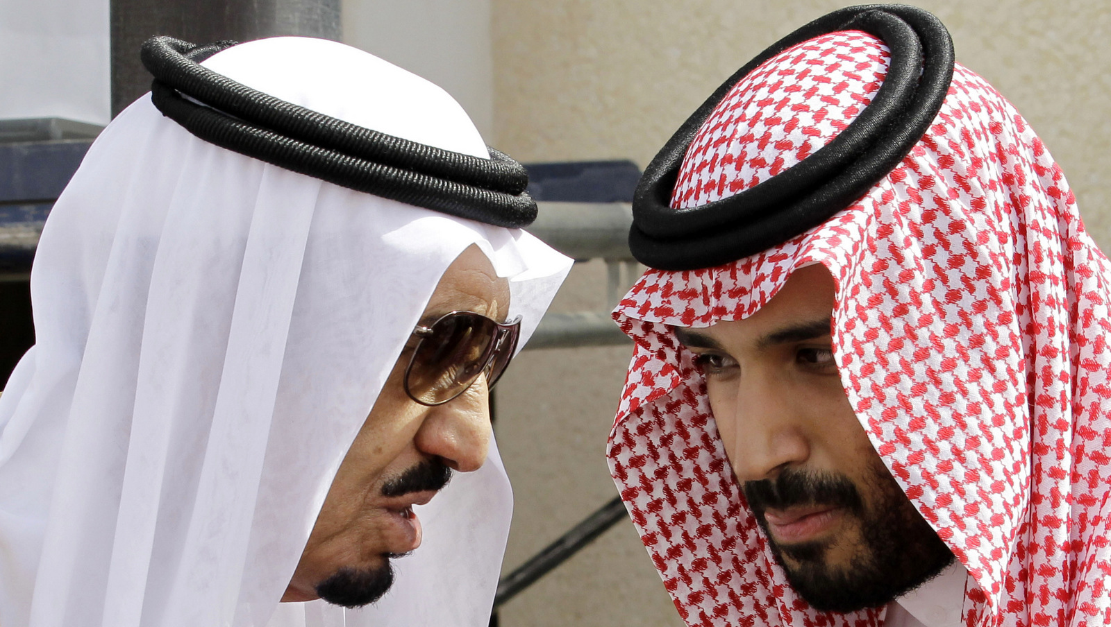 Saudi King Salman, left, speaks with his son Prince Mohammed bin Salman as they wait for Gulf Arab leaders ahead of the opening of a Gulf Cooperation Council summit, in Riyadh, Saudi Arabia. On Wednesday, April 29, 2015. (AP Photo/Hassan Ammar)