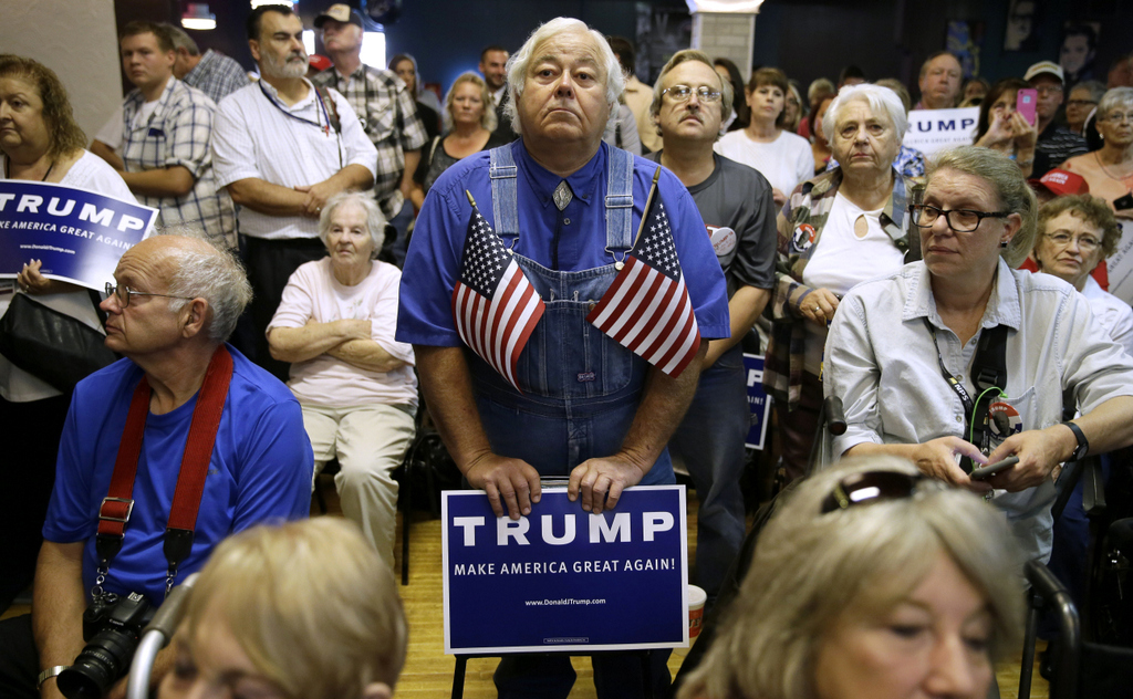 Bob McNamara of Spillville, Iowa, and others, listen to Republican presidential candidate Donald Trump speaks during a campaign stop at the Electric Park Ballroom, Wednesday, Oct. 7, 2015, in Waterloo, Iowa. (AP Photo/Charlie Neibergall)