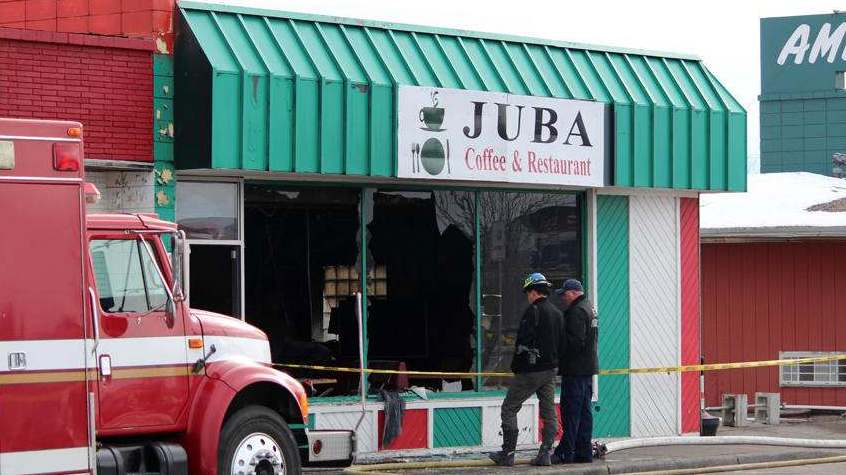 Investigators could be seen taking pictures of the site and digging through debris at Juba Coffee House, where a fire broke out in the early hours of Tuesday morning. Grand Forks Herald photo by Sarah Volpenhein.