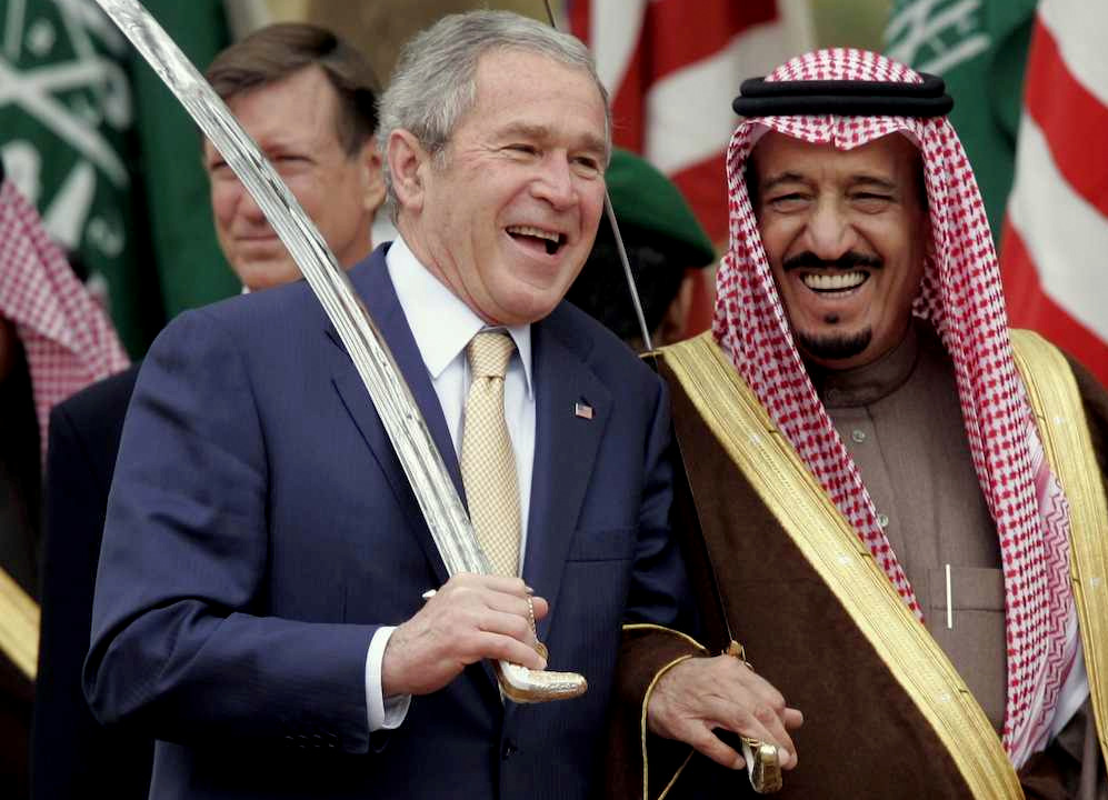 King Salman, the current ruler of Saudi Arabia, poses with former U.S. president George W. Bush. (AP Photo)