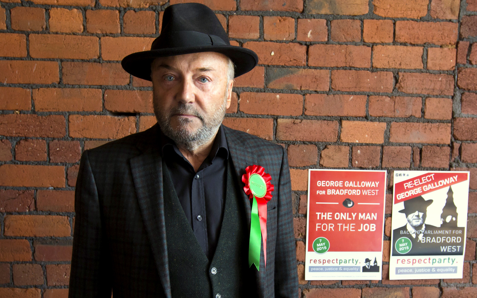 Respect Party Leader George Galloway poses for a picture after an interview at his offices in the constituency of Bradford West, in Bradford, England. (AP Photo/Jon Super)