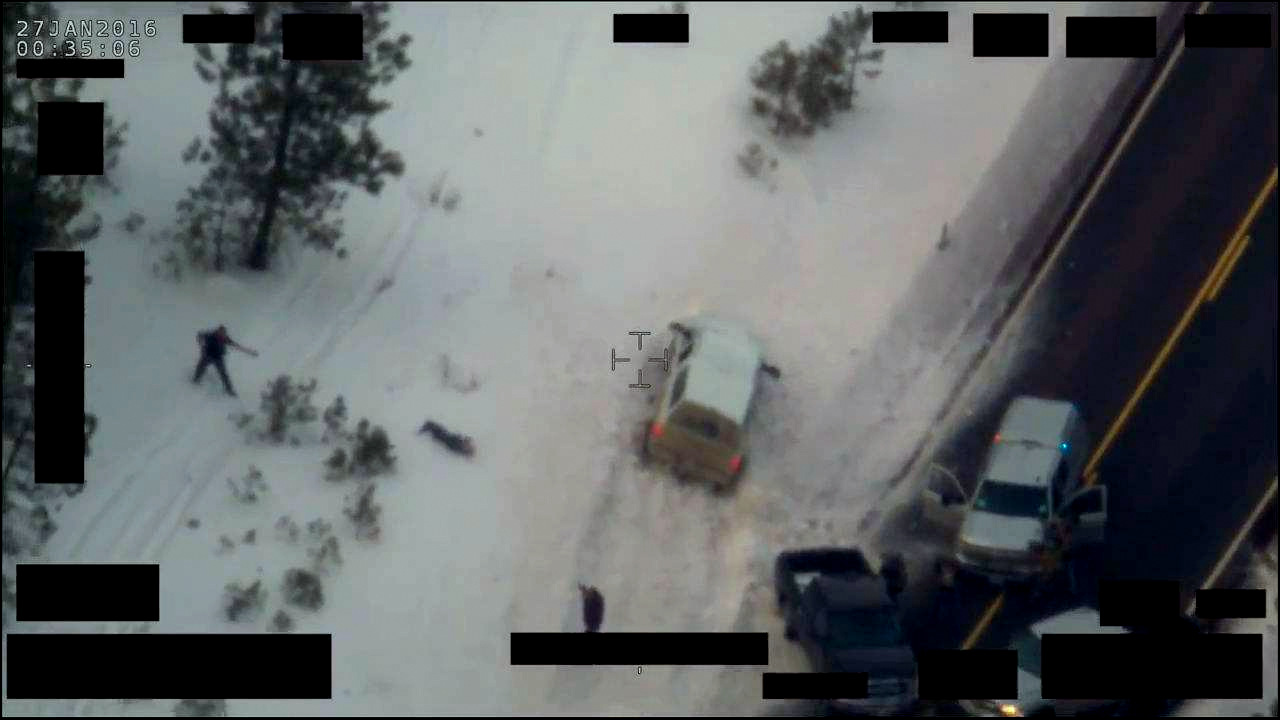 LaVoy Finicum lays dead in the snow after being shot and killed by police in Burns, Oregon.
