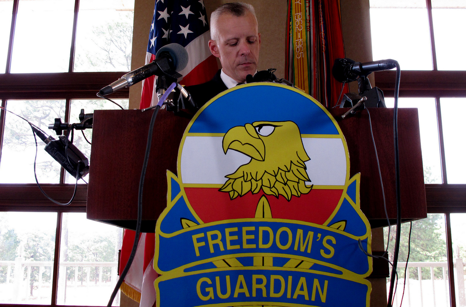 U.S. Army Col. Daniel King addresses the news media about charges against Army Sgt. Bowe Bergdahl at Fort Bragg, N.C., on Wednesday, March 25, 2015. Bergdahl, who abandoned his post in Afghanistan and was held captive for five years by the Taliban, was charged Wednesday by the U.S. military with desertion and misbehavior before the enemy and could get life in prison if convicted. (AP Photo/Allen G. Breed)
