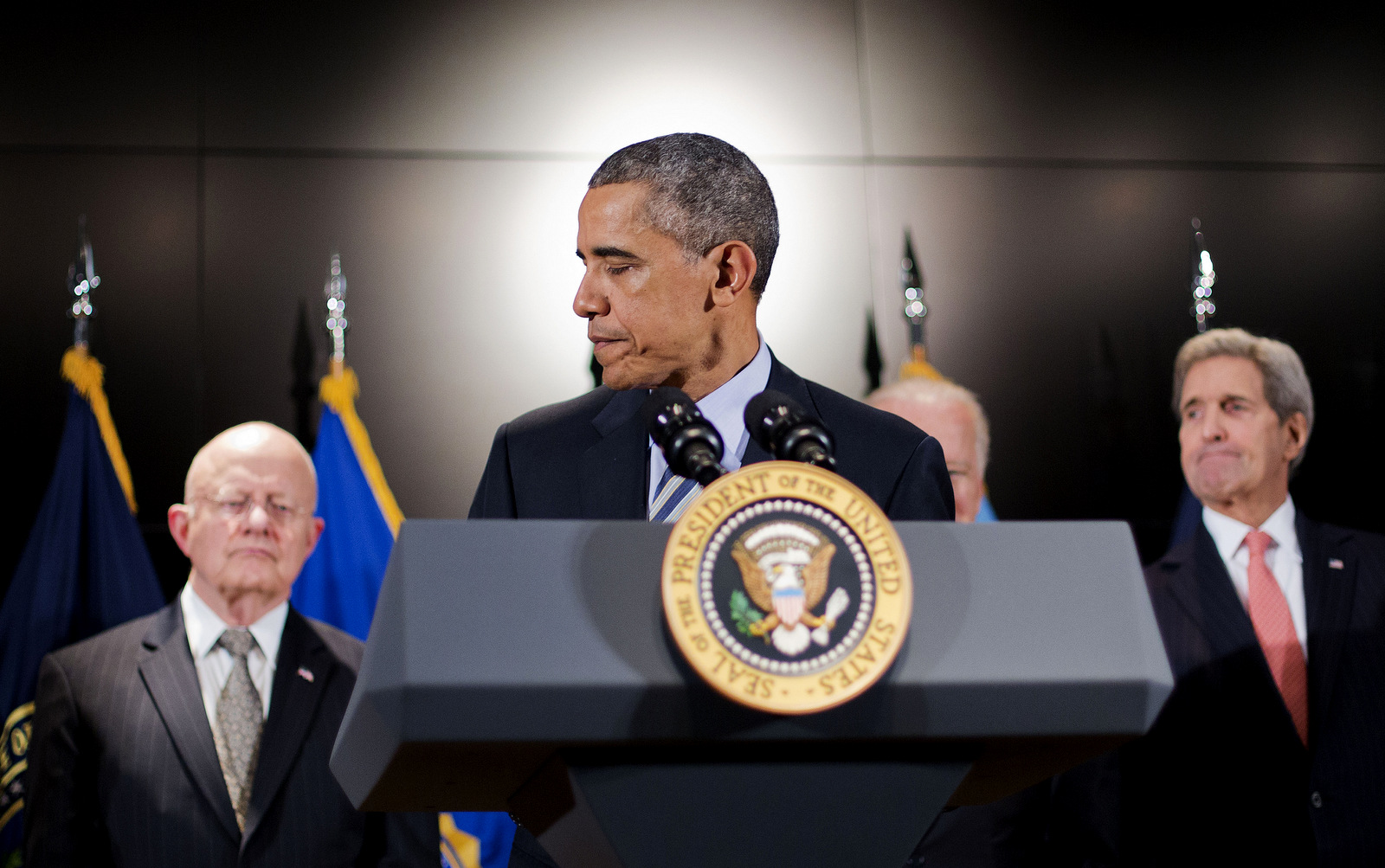 President Barack Obama, accompanied by, from left, Office of National Intelligence Director James Clapper, Vice President Joe Biden, and Secretary of State John Kerry, walks away from the podium after speaking at the National Counterterrorism Center in McLean, Va.,Thursday, Dec. 17, 2015. (AP Photo/Pablo Martinez Monsivais)