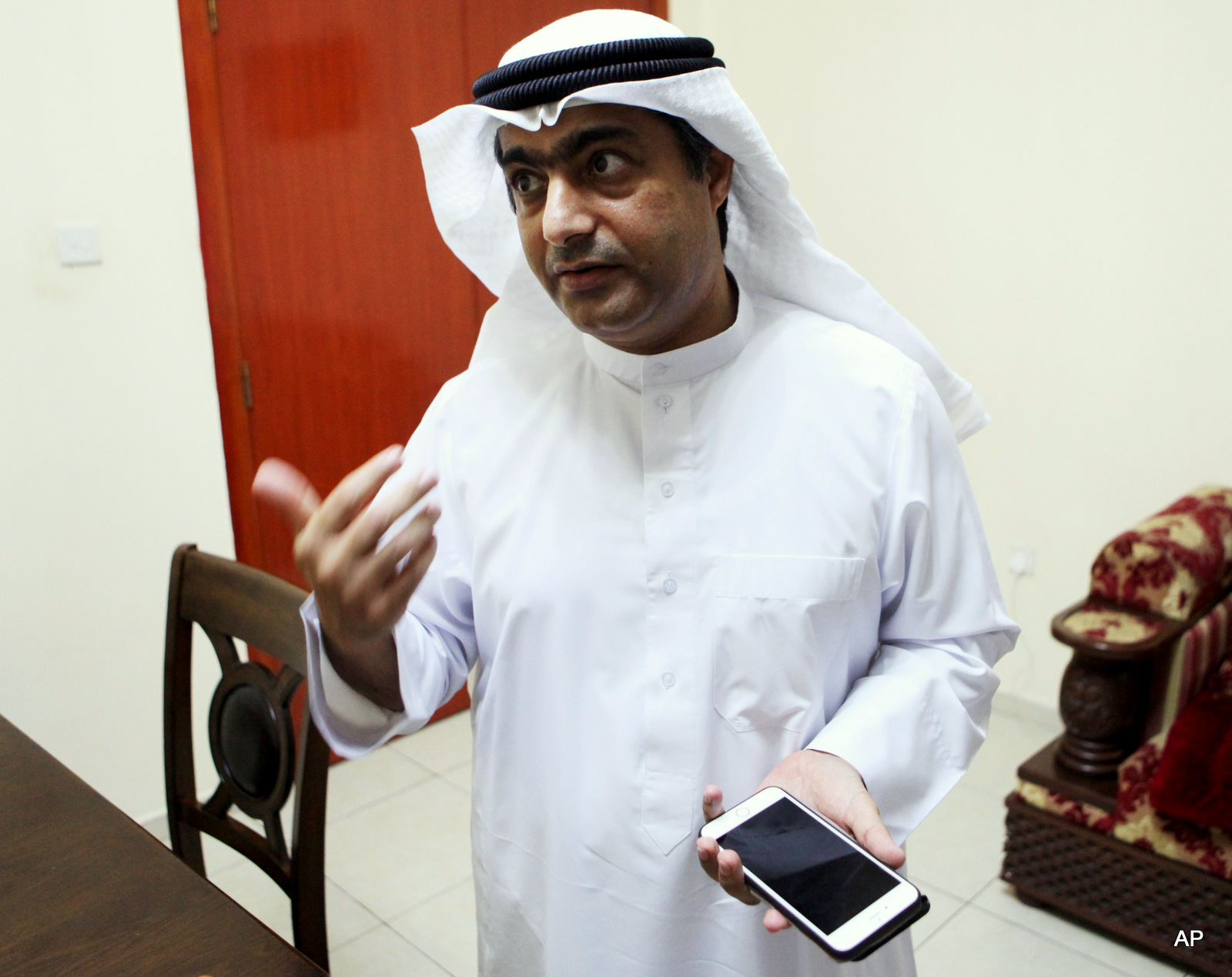 Human rights activist Ahmed Mansoor speaks to journalists in Ajman, United Arab Emirates, on Thursday, Aug. 25, 2016. Mansoor was recently targeted by NSO spyware that can hack into Apple's iPhone handset.