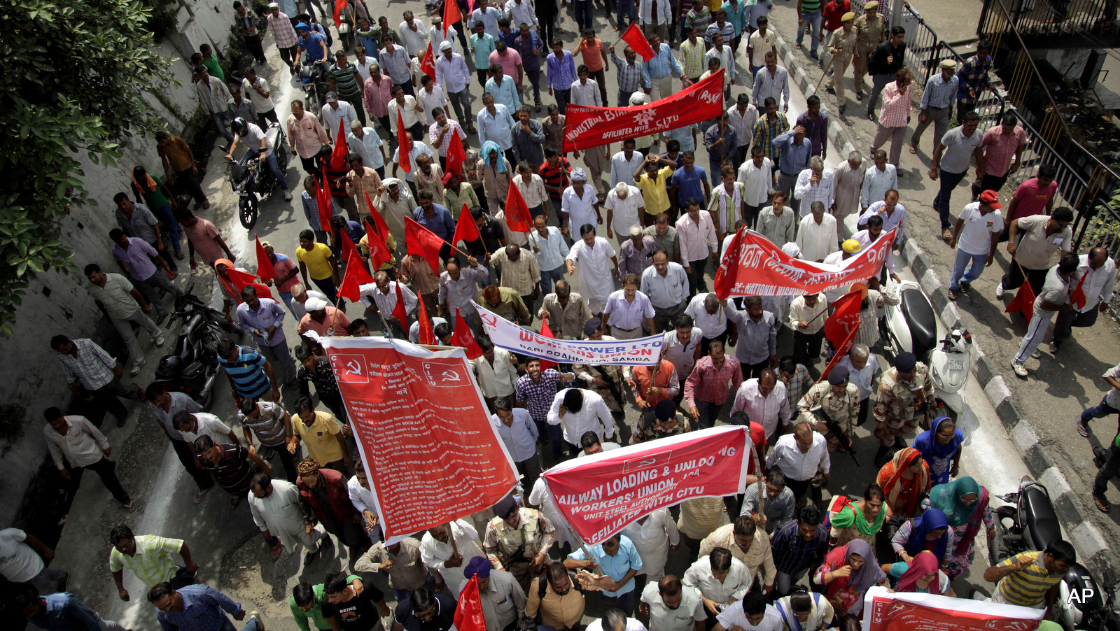 Indian workers participate in a rally during a nationwide strike called by trade unions, in Jammu, India, Sept. 2, 2016.The strike has been called against the government's alleged anti labor policies. Activists also demanded higher minimum wages and provision of social security for workers from unorganized sectors.