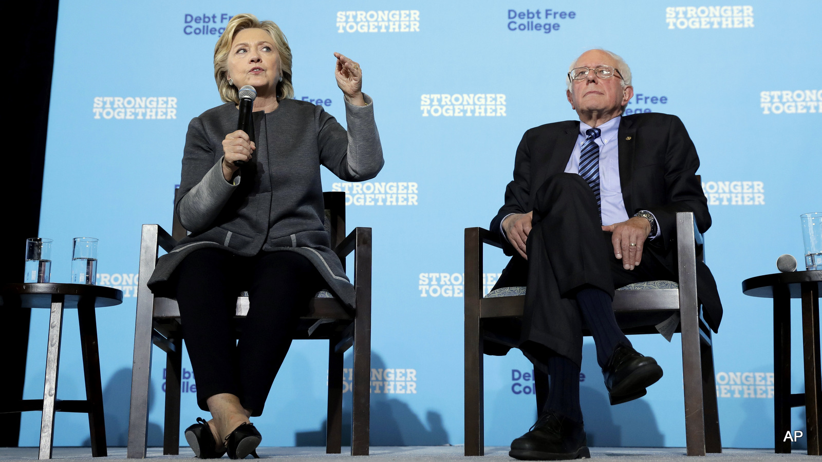 Democratic presidential candidate Hillary Clinton and Sen. Bernie Sanders, I-Vt. participate in a panel discussion during a campaign stop at the University Of New Hampshire in Durham, N.H., Wednesday, Sept. 28, 2016.