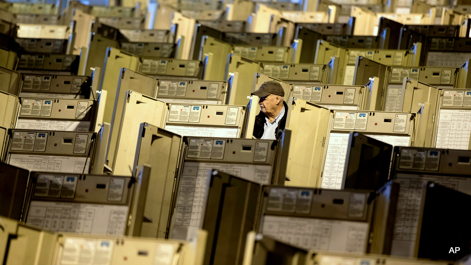A technician works to prepare voting machines to be used in the upcoming presidential election, in Philadelphia, Friday, Oct. 14, 2016.