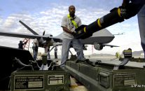 Photo of Hellfire missiles being loaded onto a US military Reaper drone in Afghanistan by Staff Sgt. Brian Ferguson/U.S. Air Force