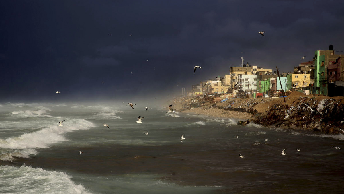 Seagulls fly over the Mediterranean Sea during a rainstorm, along the coast off the Shati refugee camp, in Gaza City, Tuesday, Dec. 27, 2016. (AP/Adel Hana)