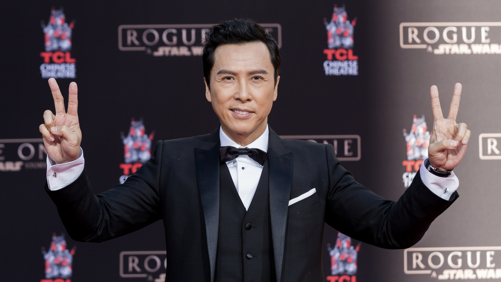 "Actor Donnie Yen, of ""Rogue One: A Star Wars Story,"" appears at his hand and footprint ceremony at the TCL Chinese Theatre on Wednesday, Nov. 30, 2016, in Los Angeles. (Photo by Willy Sanjuan/Invision/AP)"