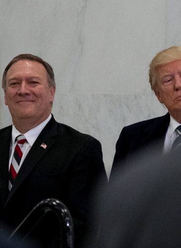 President Donald Trump, accompanied by CIA Director-designate Rep. Michael Pompeo, left, waits to speak at the Central Intelligence Agency in Langley, Va., Saturday, Jan. 21, 2017. (AP/Andrew Harnik)