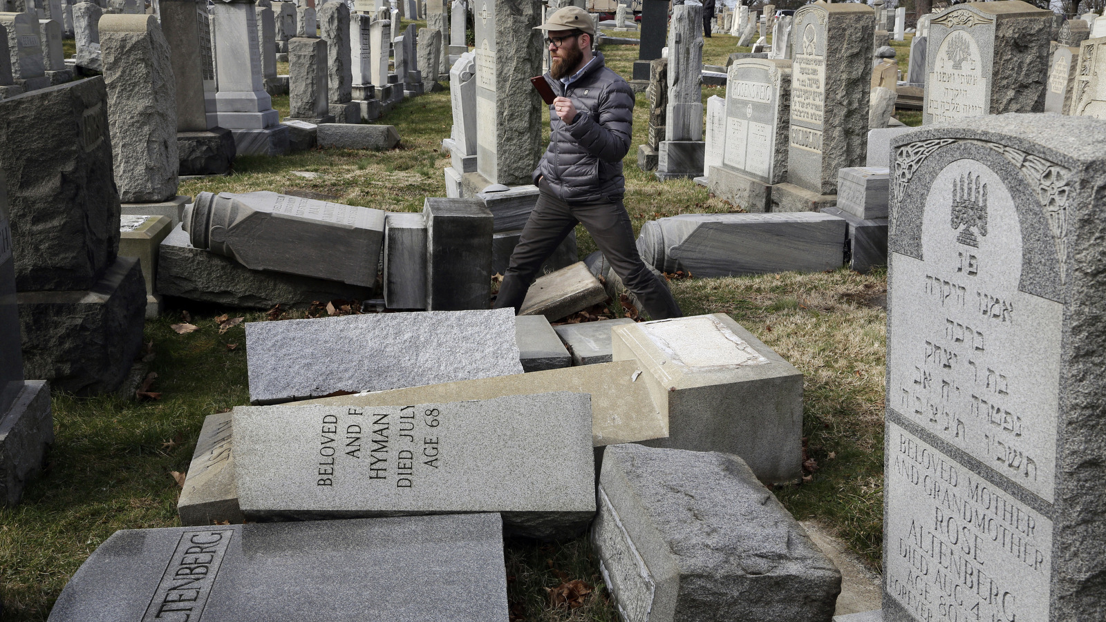 Rabbi Joshua Bolton of the University of Pennsylvania's Hillel center surveys damaged headstones at Mount Carmel Cemetery on Monday, Feb. 27, 2017, in Philadelphia. More than 100 headstones have been vandalized at the Jewish cemetery in Philadelphia, damage discovered less than a week after similar vandalism in Missouri, authorities said. (AP/Jacqueline Larma)