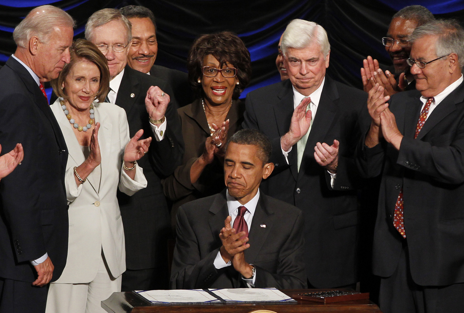 Barack Obama signs the Dodd-Frank Wall Street Reform and Consumer Protection financial overhaul bill at the Ronald Reagan Building in Washington, Wednesday, July 21, 2010. (AP/Charles Dharapak)