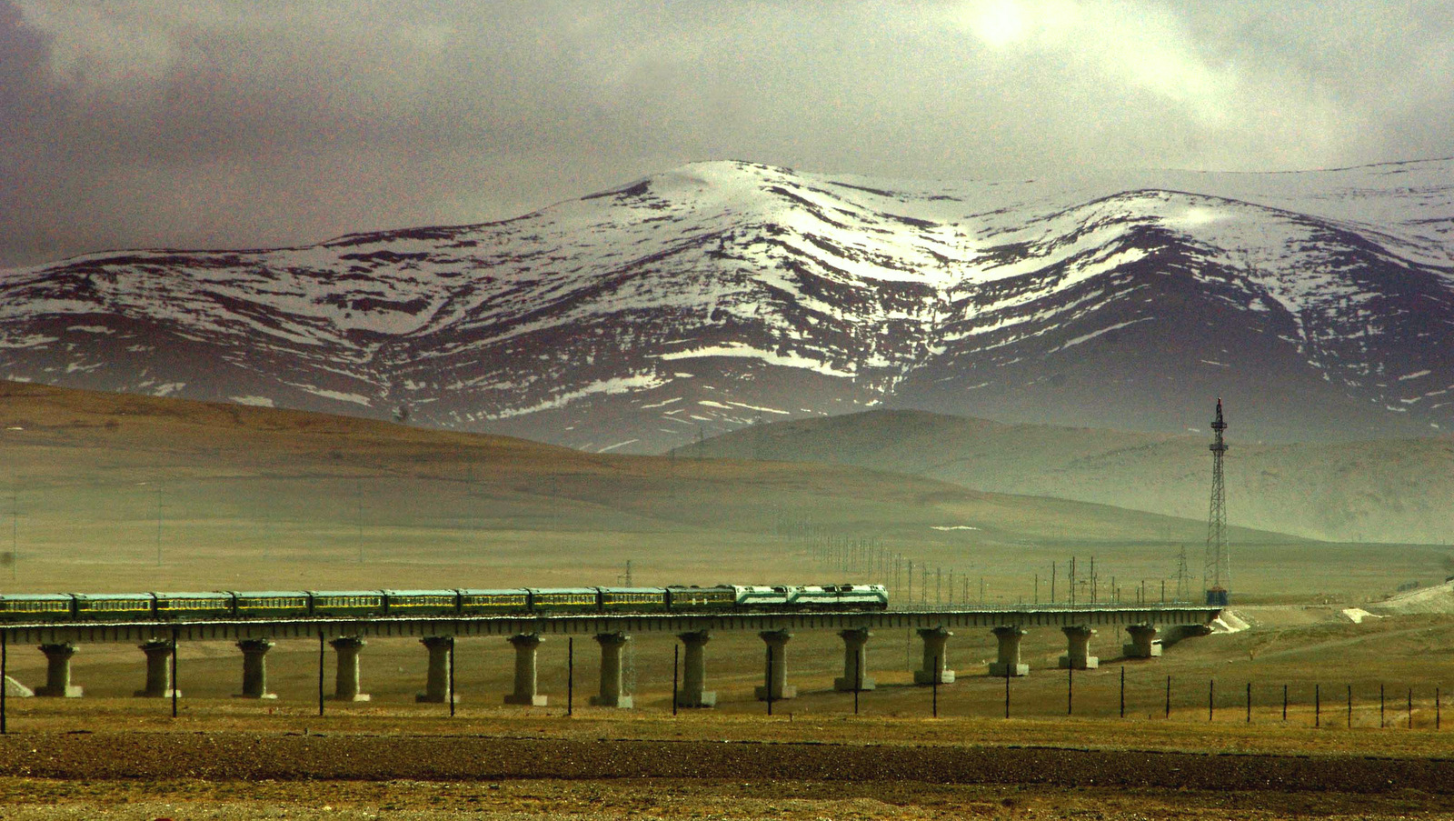 A train runs along the Qinghai-Tibet Railway in the section of Golmud, northwest China's Qinghai Province. (AP/ Xinhua, Chen Xie)