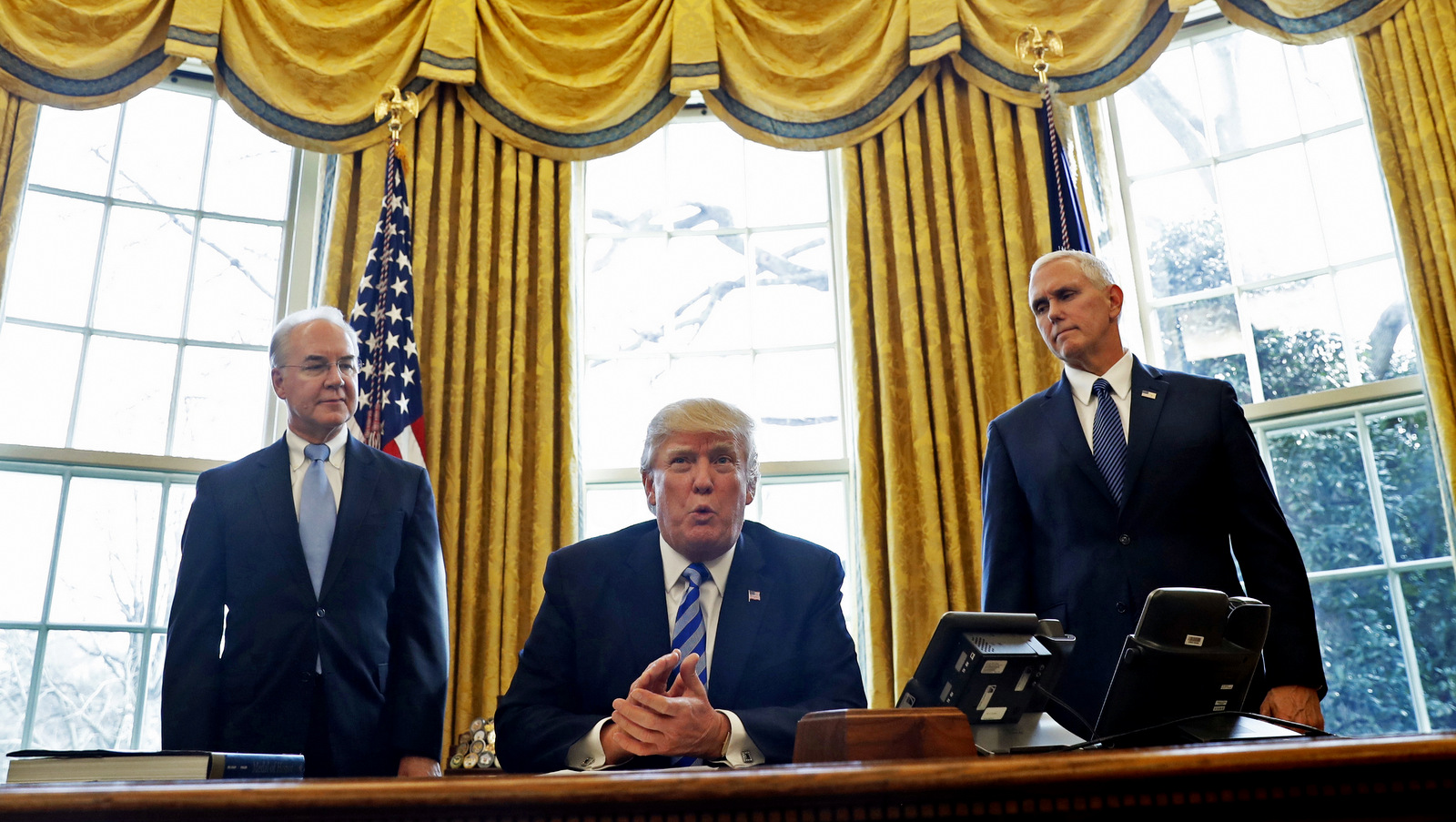 President Donald Trump, flanked by Health and Human Services Secretary Tom Price, left, and Vice President Mike Pence, meets with members of the media regarding the health care overhaul bill, March 24, 2017. (AP/Pablo Martinez Monsivais)