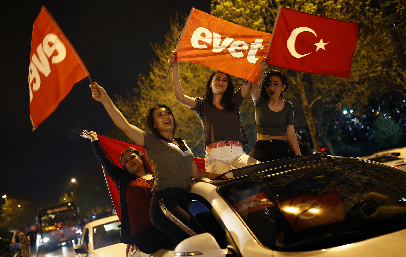 "Supporters of the ""Yes"" vote, wave flags during celebrations in Istanbul, on Sunday, April 16, 2017. The flags read in Turkish : ""Yes"". (AP/Emrah Gurel)"
