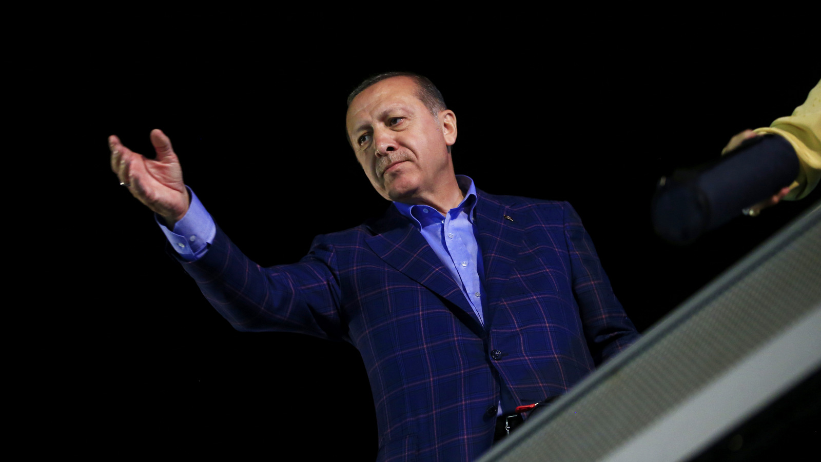 "Turkey's President Recep Tayyip Erdogan, waves to supporters in Istanbul, on Sunday, April 16, 2017. Erdogan declared victory in Sunday's historic referendum that will grant sweeping powers to the presidency, hailing the result as a ""historic decision."" (AP/Lefteris Pitarakis)"