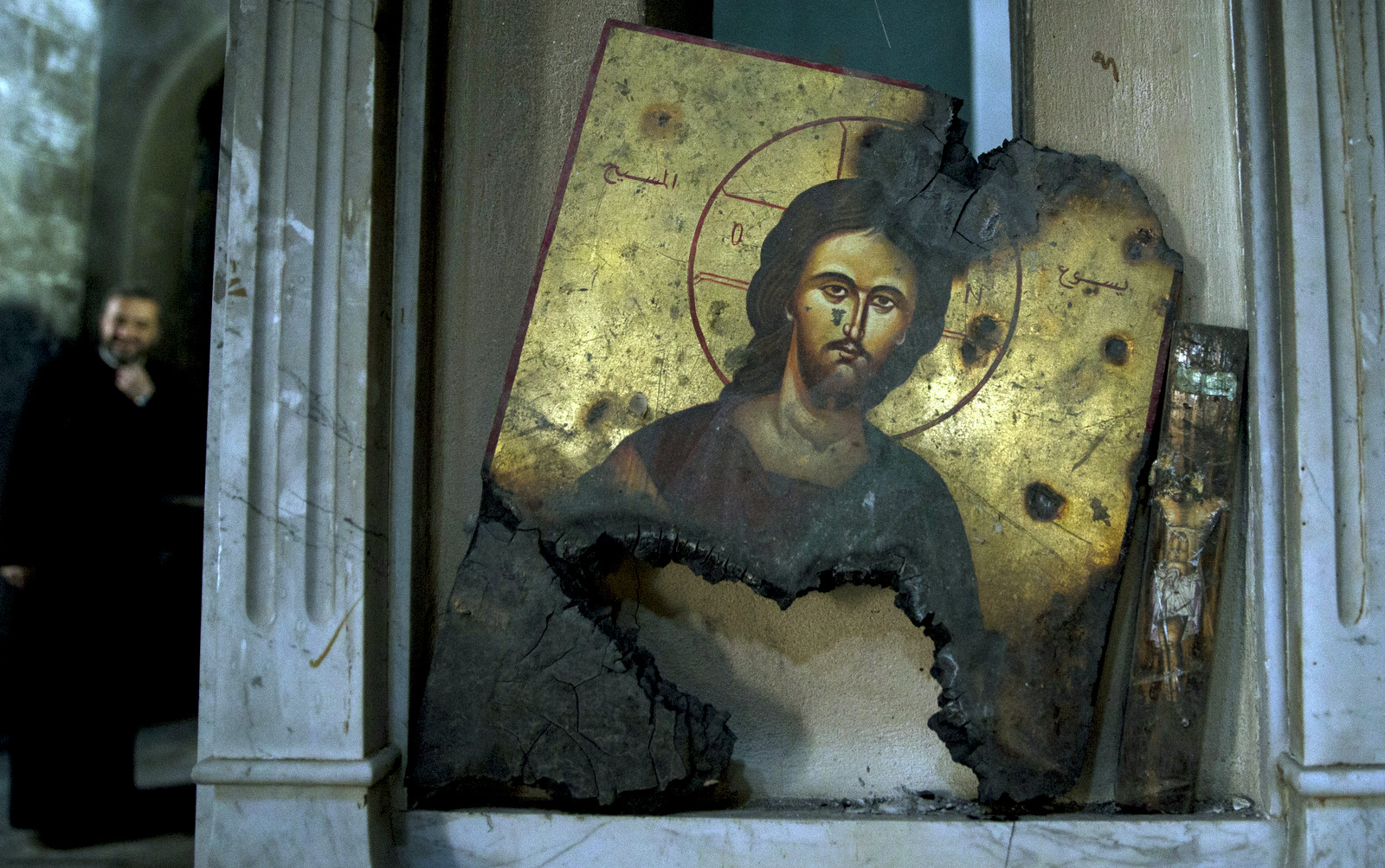 A half-burned image of Christ is placed next to a wall at a Greek Orthodox church in Maaloula, Syria, March 3, 2016. Maaloula, an ancient Christian town 40 miles northeast of Damascus, changed hands several times in the war. Its historic churches pillaged by Syrian rebels and buildings riddled with shrapnel reflect fierce fighting that devastated the town two years ago. (AP/Pavel Golovkin)
