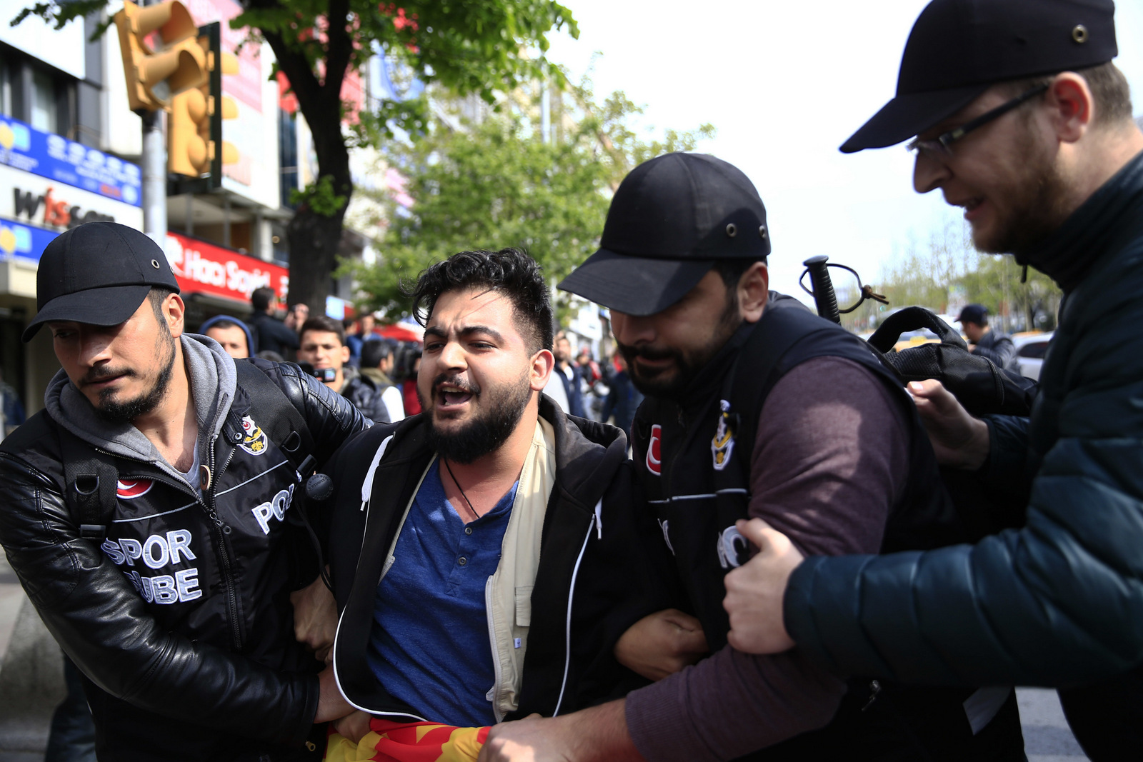 Police arrest demonstrators as they tried to march during May Day, in Istanbul, Monday, May 1, 2017.