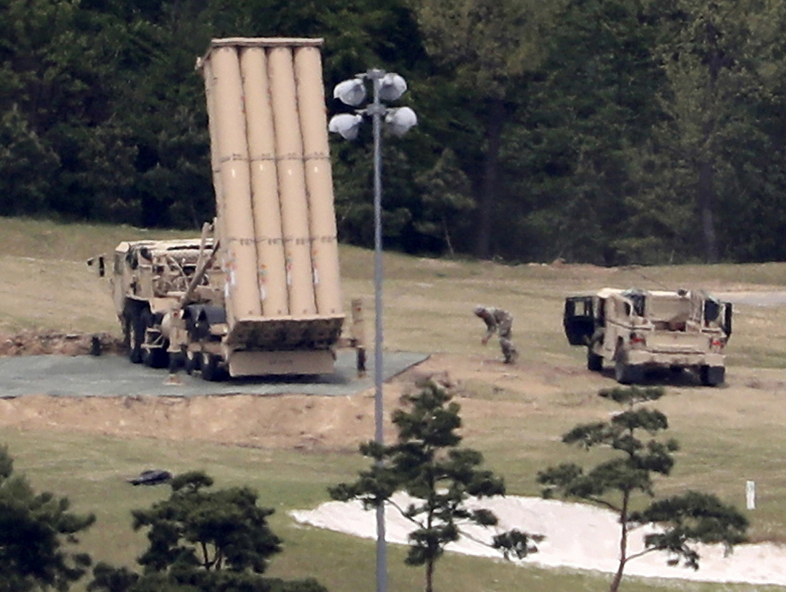 A U.S. missile defense system called Terminal High Altitude Area Defense, or THAAD, is installed on a golf course in Seongju, South Korea. (Kim Jun-beom/Yonhap via AP)