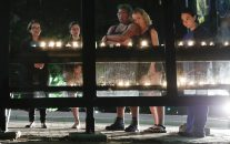 People gather for a candlelight vigil at a bus shelter at the University of Maryland in College Park, Md, May 21, 2017, where visiting student was fatally stabbed. (AP/Carolyn Kaster)