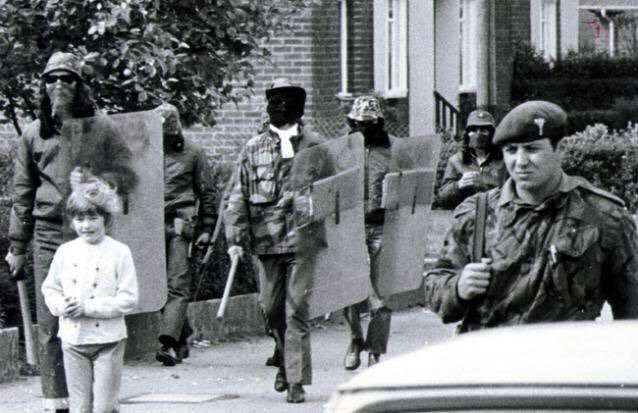 British troops and UDA members on joint patrol at Clon Duff Drive in Belfast, 1972 during the tumultuous times known as 'The Troubles.'