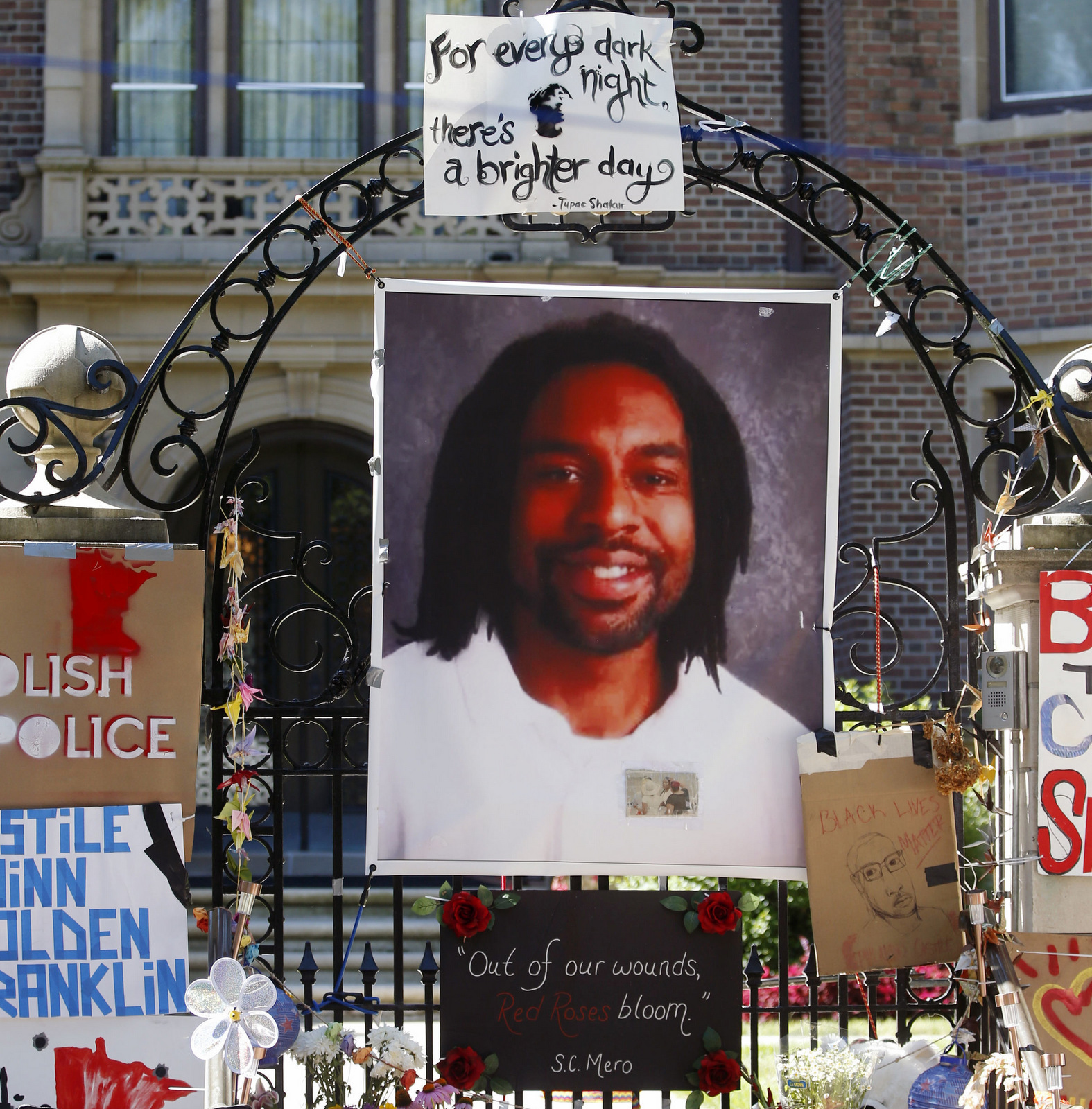 A memorial including a photo of Philando Castile adorns the gate to the governor's residence where protesters demonstrated in St. Paul, Minn., against the July 6 shooting death of Castile. (AP/Jim Mone)