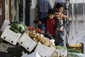 Syrian children buy vegetables at the town of Madaya in the Damascus countryside, Syria, May 18, 2017. (AP/Hassan Ammar)