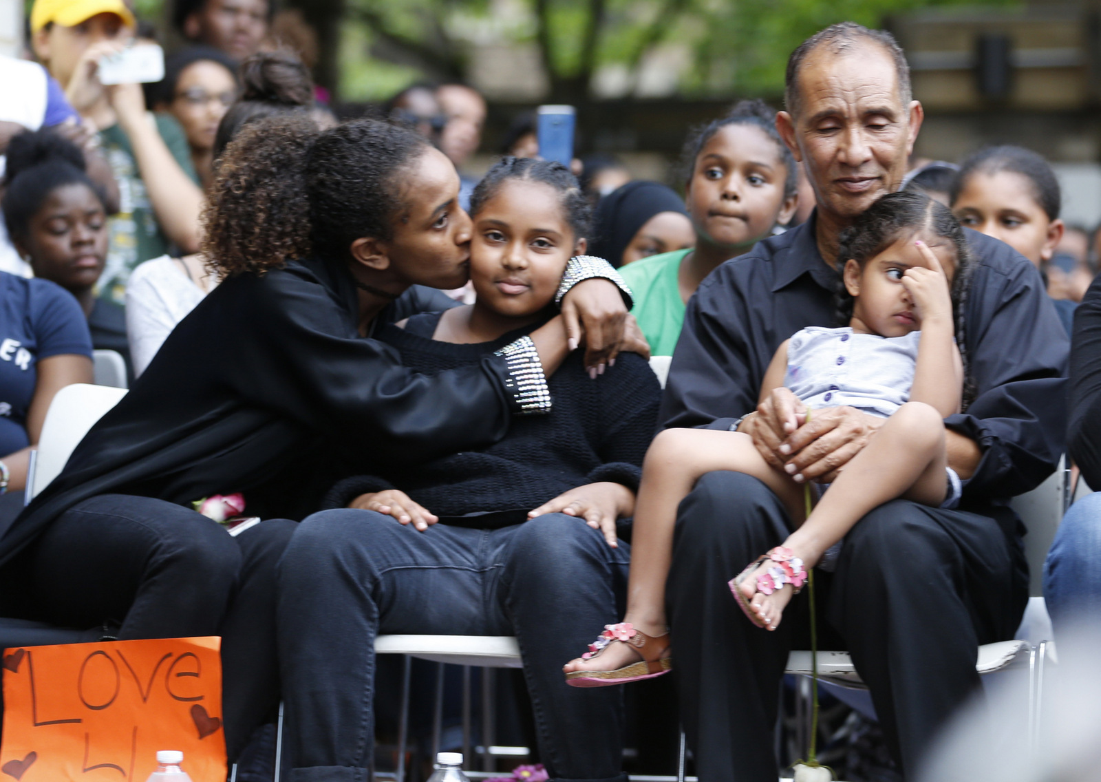 Mahmoud Hassanen Aboras father of Nabra Hassanen, who was killed over the weekend, sits with family as he listens to speakers during a vigil in honor of Nabra Wednesday, June 21, 2017, in Reston, Va. (AP/Steve Helber)