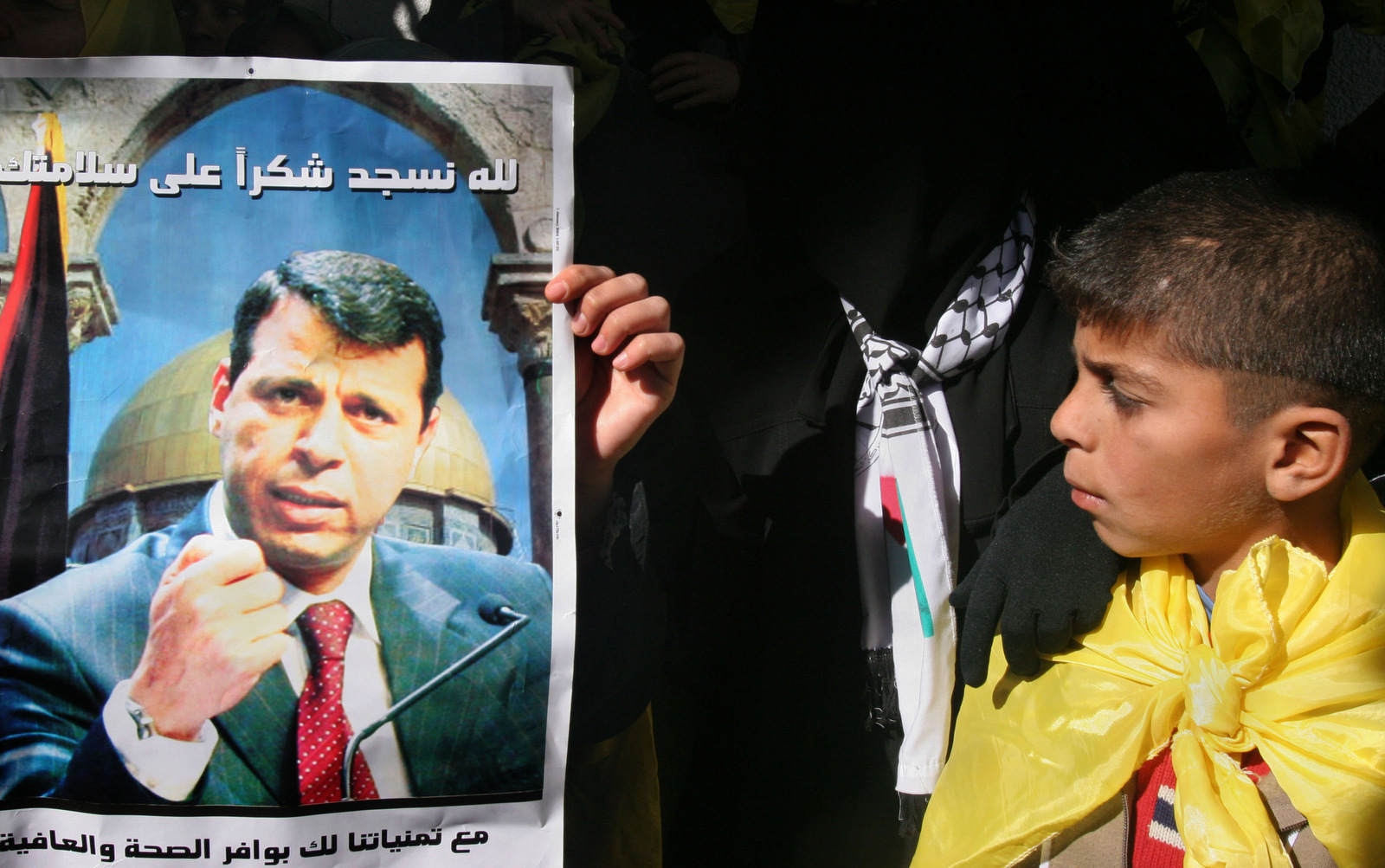 A Palestinian boy looks at a poster of Fatah leader Mohammed Dahlan during a rally in support of him in Gaza City, Dec. 16, 2006. (AP/Hatem Moussa)