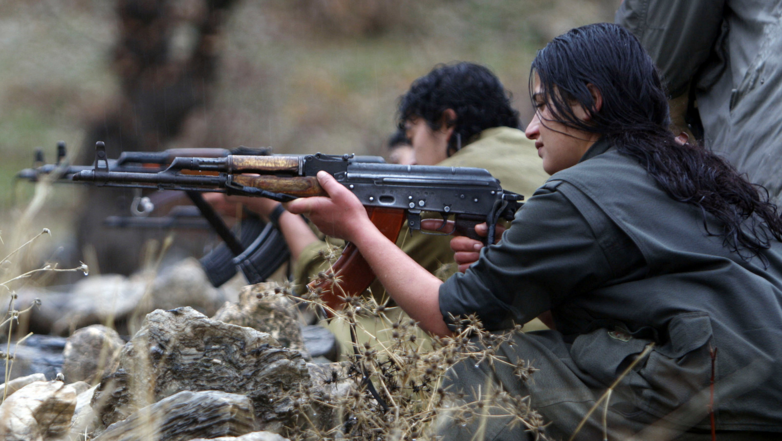 In this 2009 photo, a member of the Free Life Party, or PJAK, fires a rifle at a clandestine weapons training camp in the Qandil mountains of northern Iraq. (AP/Yahya Ahmed)
