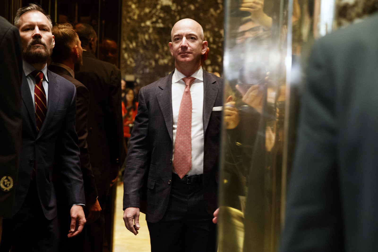 Amazon CEO and Wahsington Post owner, Jeff Bezos on an elevator for a meeting with then President-elect Donald Trump at Trump Tower in New York, Dec. 14, 2016. (AP/Evan Vucci)