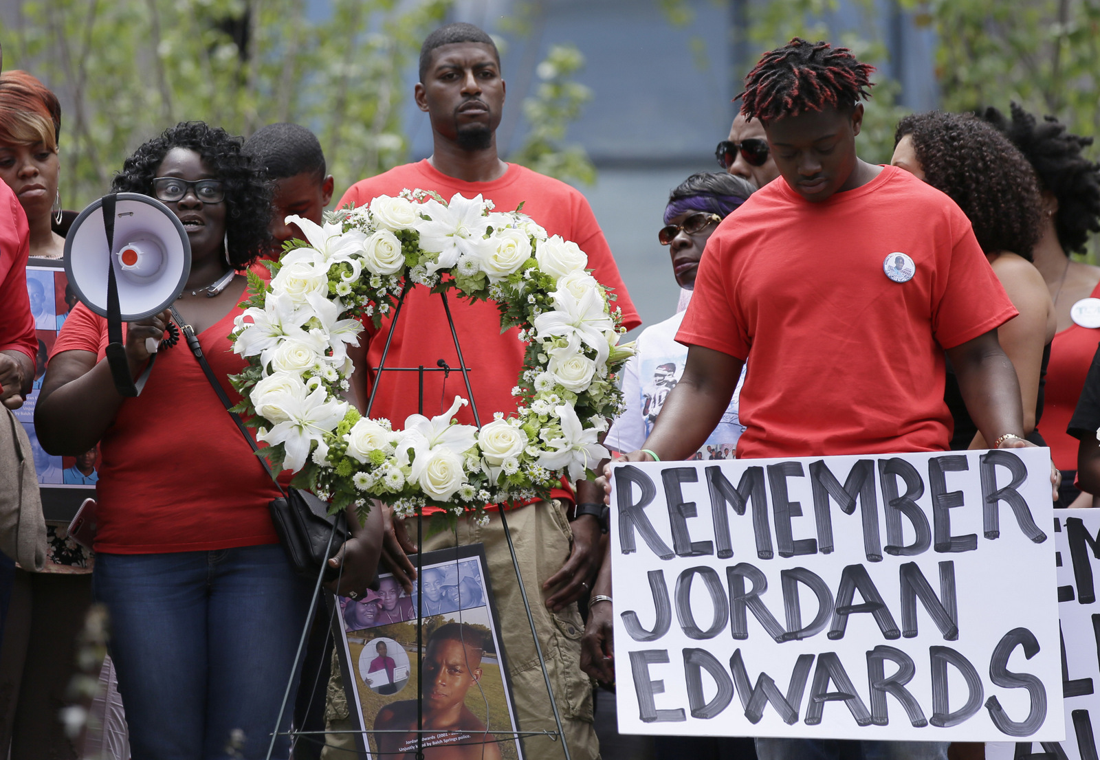Slain teen Jordan Edwards' mother Charmaine Edwards, left, speaks to supporters with son Vidal Allen, right, and husband Odell Edwards during a protest outside the court house in Dallas.(AP/LM Otero)